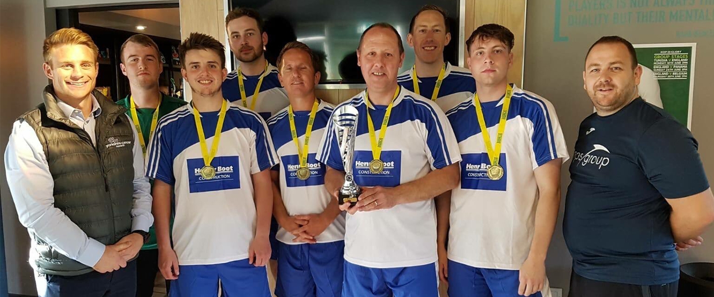 Team Henry Boot with their winners medals and trophy