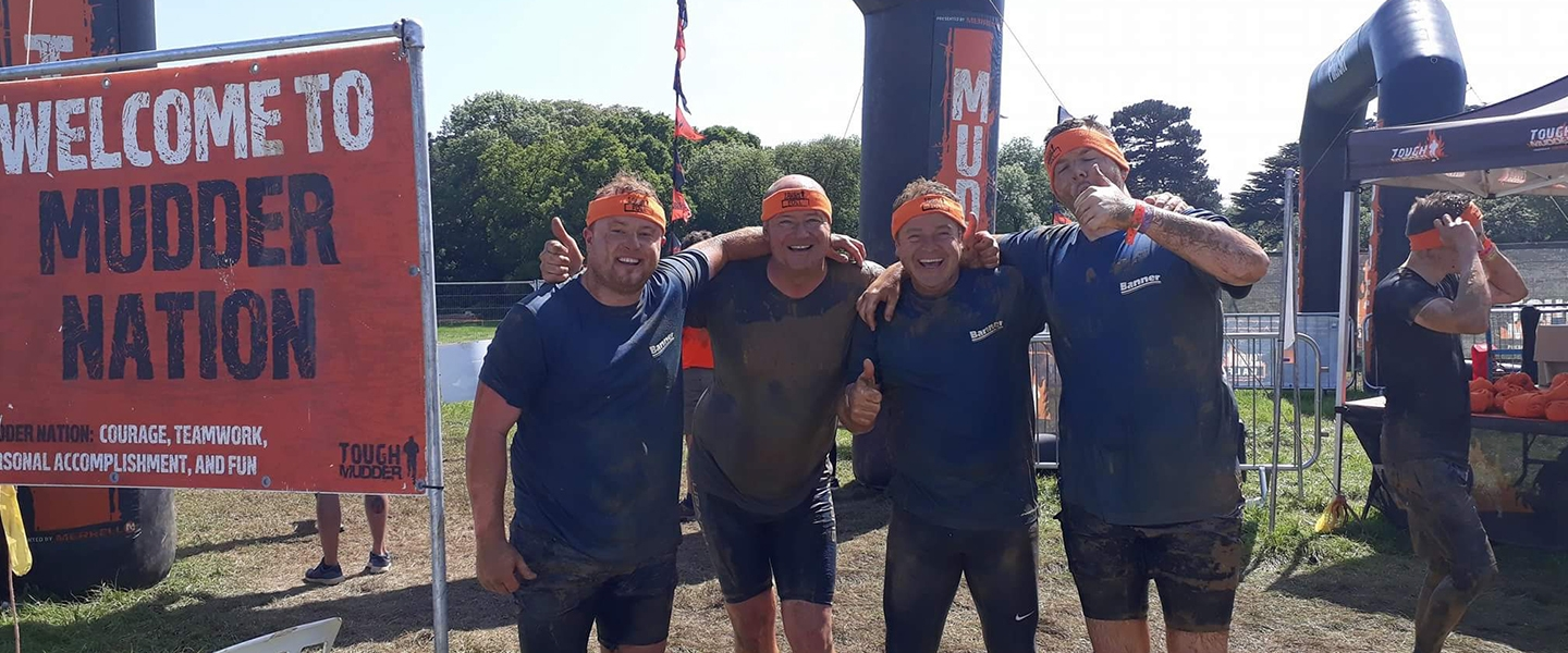 Employees from Banner after completing Tough Mudder. Left to right: Bradley Hughes, Glenn Palmer, Rob Hughes and Chris Winder.